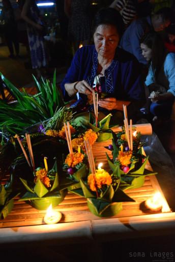 woman creating floating lanterns Loy Krathong 2014