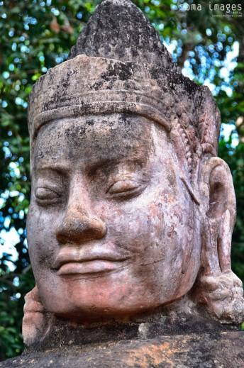 Roadside statue stands guard, Angkor Wat, Cambodia