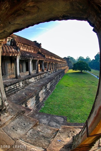 Peering out of Angkor Wat in Cambodia